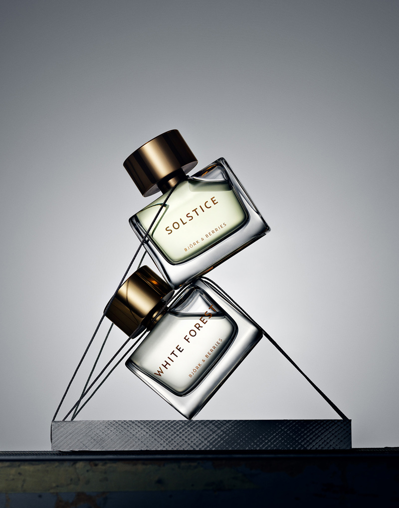 two perfume bottles by björk and berries